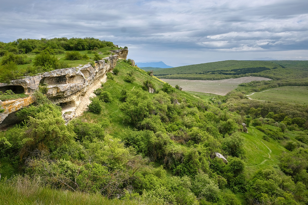 Mountain valley among rocks covered with vegetation and forest. Beautiful landscape in the mountains of Crimea